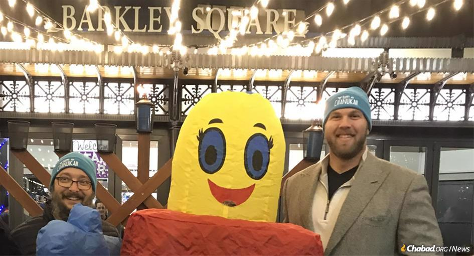 Kansas City Chiefs' star lineman Mitchell Schwartz with Rabbi Mendy Wineberg at a Chanukah celebration in the city of Leawood in Johnson County, part of the Kansas City metropolitan area.