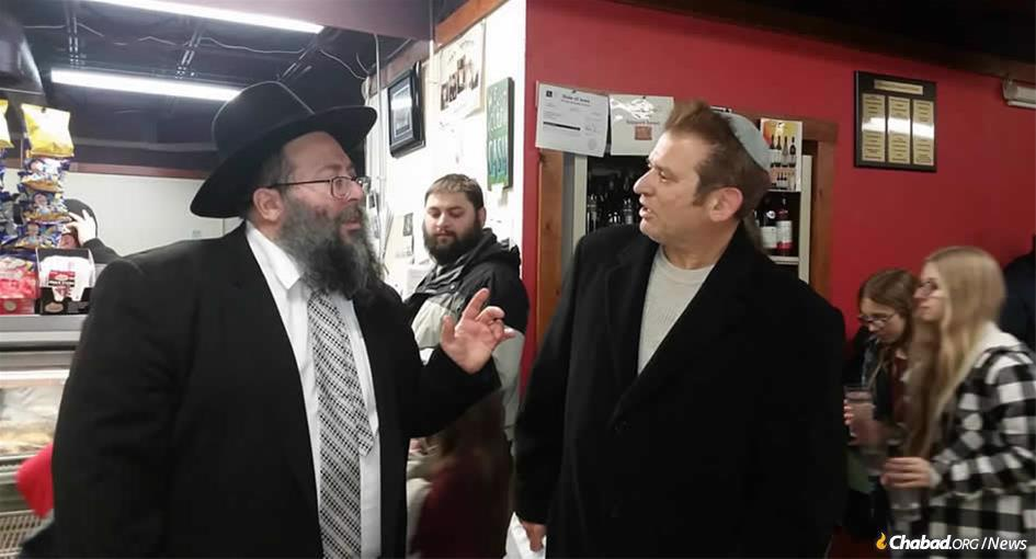 Rabbi Yossi Jacobson, left, with popular Iowa radio host Simon Conway at Maccabees Kosher Deli, which has long served as a campaign stop for every candidate and party. It is Iowa's only full-service kosher deli and grocery.