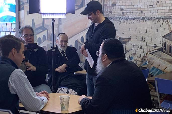 The rabbi gets his own fair share of media attention as he hosts Jewish campaign workers of every political persuasion and party. Here, he's interviewed by Fox News.