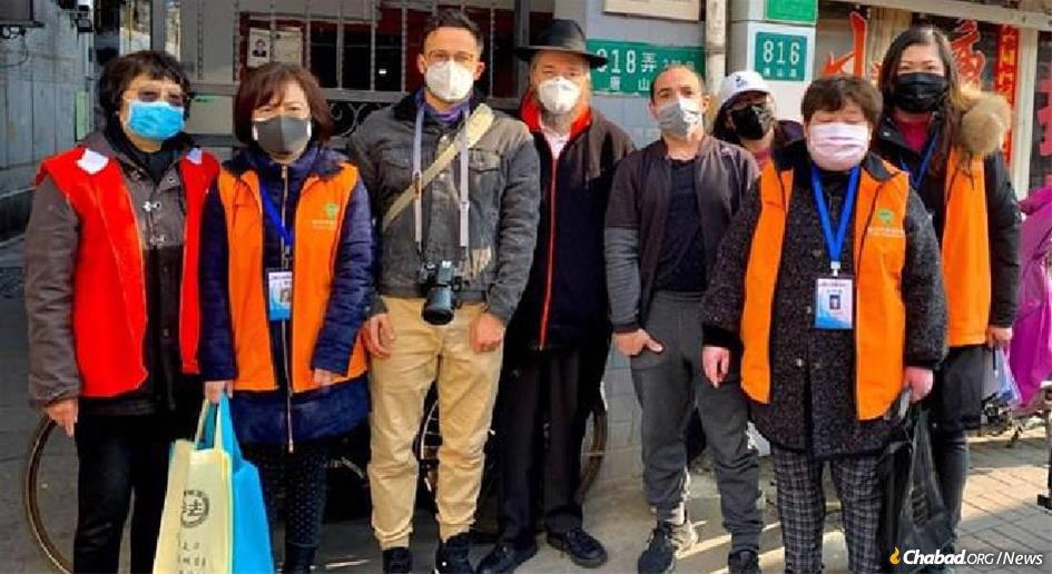 In Shanghai, Rabbi Shalom Greenberg, co-director of Chabad of Shanghai, center, and other volunteers from the Jewish community went door to door in various neighborhoods of the city to distribute face masks to the elderly and the sick to help protect them from the coronavirus.