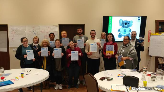 Participants in the Mental Health First Aid class in Houston display their certificates.