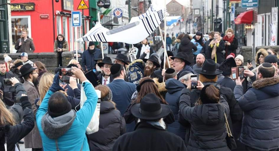 Celebrants danced down the streets of Reykjavik, the capital of Iceland, to mark the first-ever completion and inauguration of a Torah scroll on the European island. (Photo: Gabriel Rutenberg)