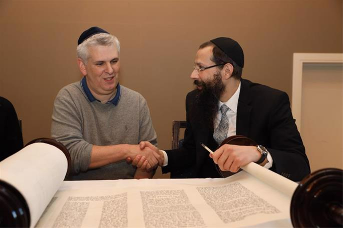 Jewish community members incribed letters in the Torah scroll, a memory that would last a lifetime. (Photo: Gabriel Rutenberg)