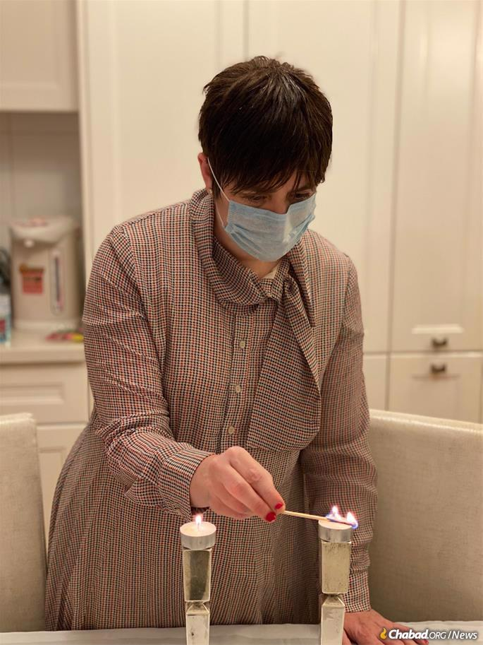 Lighting Shabbat candles a few weeks ago at the height of the coronavirus outbreak.