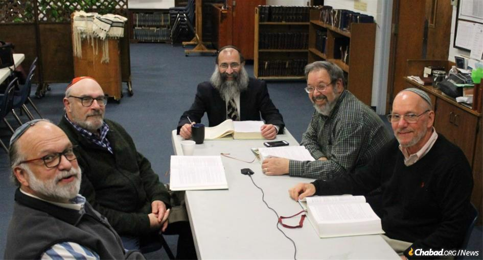 "Rudy Vogel, left, with Guillermo Muhlmann, Rabbi Chaim Kosofsky, Alan Lerman, and James Smith, who completed the study of ""Apples from the Orchard""—a tome of 1,117 pages of ""Gleanings from the Mystical Teachings of Rabbi Yitzchak Luria (the Arizal) on the Weekly Torah Portion."""