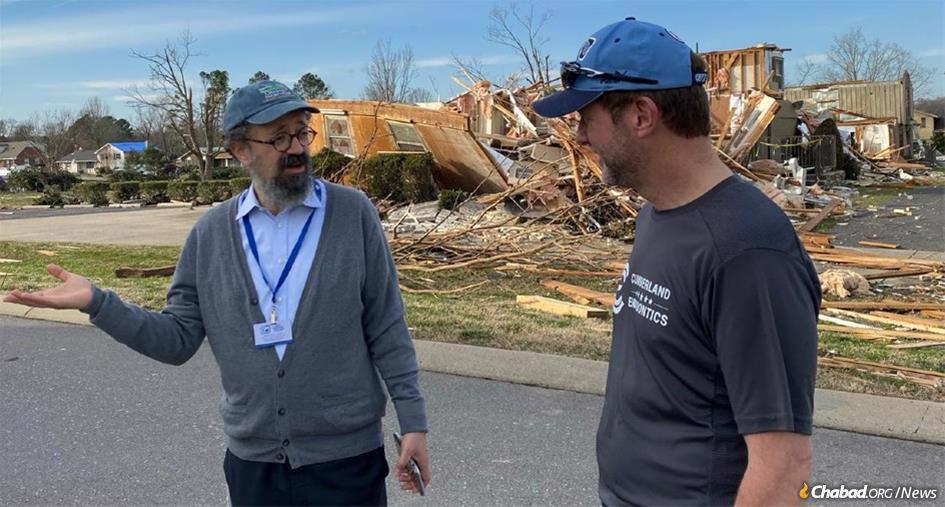 Rabbi Yitzchok Tiechtel, left, with Dr. Adam Davis of Cumberland Endodontics in Mt. Juliet, Tenn., which was severely damaged in the tornado.