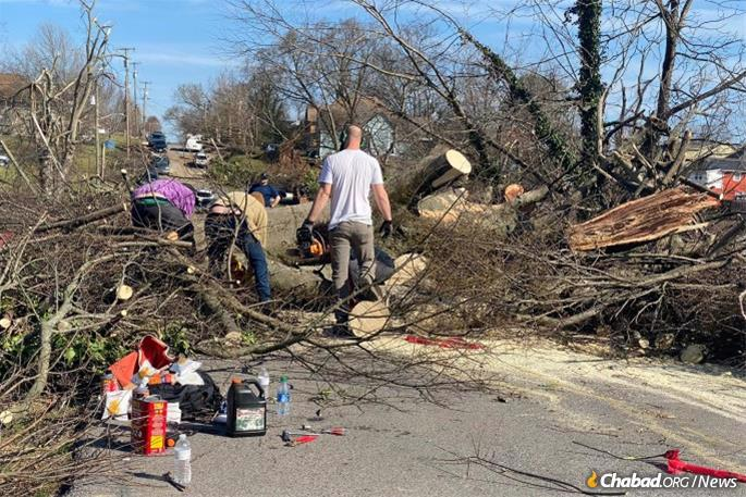 Crews and volunteers clear downed trees and power lines in Mt. Juliet, Tenn.