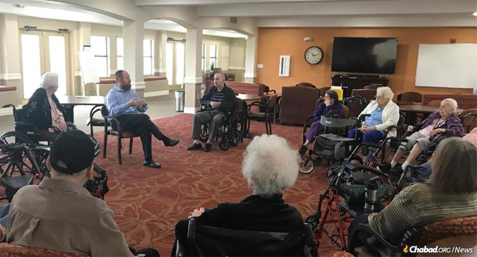 Moving online: Rabbi Levi Levertov, center, shown here last year with some of the hundreds of seniors he works with as co-director of Arizona's Smile on Seniors program. Levertov is adapting to the current crisis and is setting up online lectures, lessons and personal study sessions to keep people learning and engaged. (File photo)