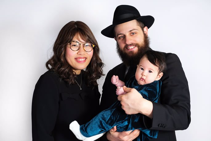 Elisheva with her husband, Dovid, and their daughter, Chana.