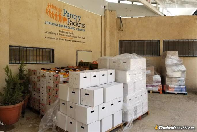 With its 23 soup kitchens across Israel shuttered and dozens of public Seders canceled as a result of the coronavirus pandemic, Colel Chabad is also home-delivering dry goods, matzah, and fruits and vegetables to thousands of families for Passover.