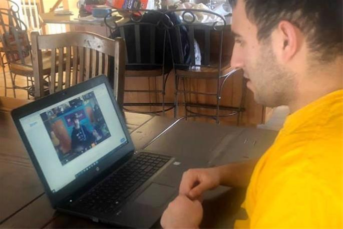 Matthew Goldstein takes part in an online class hosted by Friendship Circle of New Jersey.