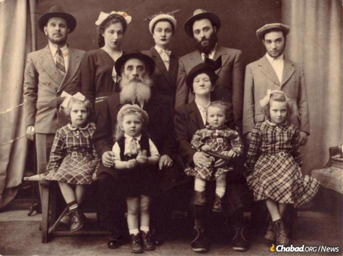 Peretz Mochkin and family before they left France. Front: Chiena (Schapiro) Lazaroff, Nachman Schapiro, Fradel (Schapiro) Mishulovin, Raizel (Schapiro) Schreiber.  Middle Row: Peretz Mochkin, Henya Chasha (Havlin) Mochkin.  Back Row: Levi Yitzchok Schapiro, Guta (Mochkin) Schapiro, Rivka (Shimanovitz) Mochkin, Yehudah Leib Mochkin, Sholom Ber Mochkin (Photo: Lubavitch of Texas Archives)