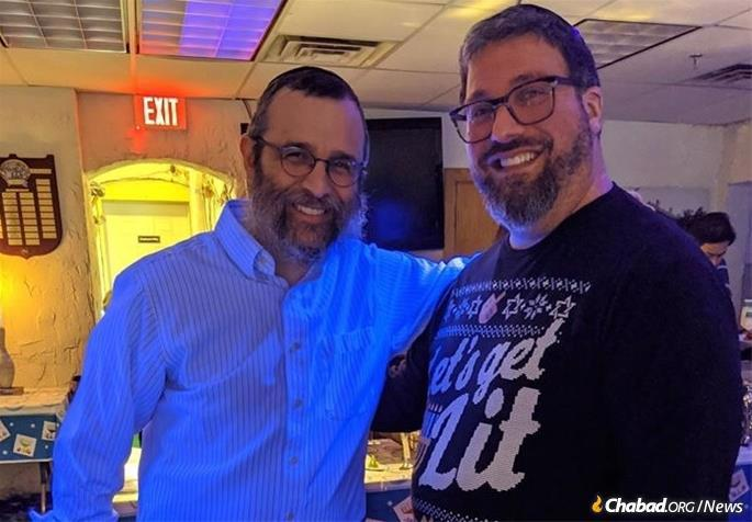 At left, Rabbi Dovid Flinkenstein, director of Chabad of Wilmette, with Ira Smith at this year's Chabad Chanukah Bowl