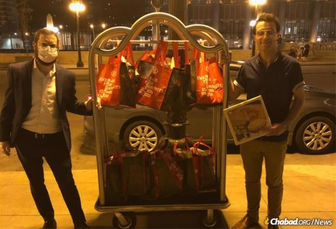 """A volunteer from Lubavitch Chabad of Illinois delivers """"Seder in a Box"""" kits for Jewish medical staff treating 3,000 coronavirus victims at a makeshift hospital in a Chicago convention center."""