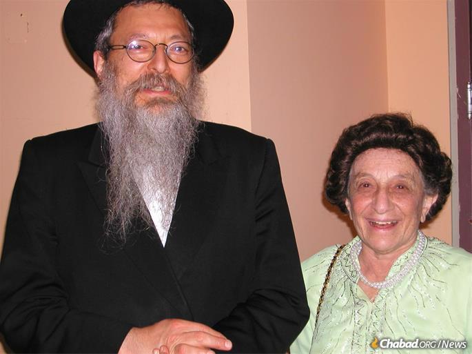 With her eldest son, Rabbi Avraham Altein.