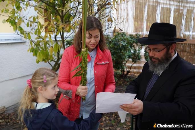 Helping a community member celebrate Sukkot.