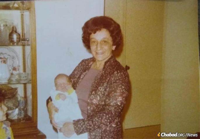Holding a grandchild. Rivkah (Altein) Strasberg.