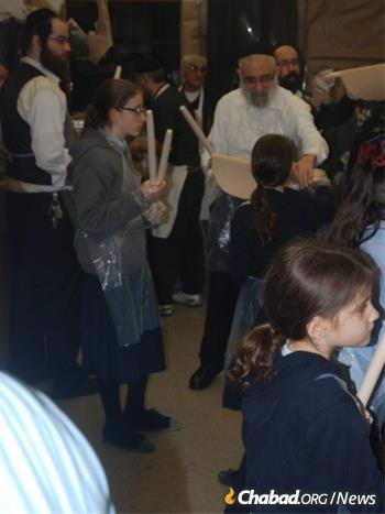 Rabbi Levy with family members at an annual matzah baking.