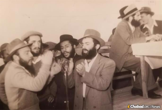 Drizin, center, with friends in Kfar Chabad, Israel in the 1950s.