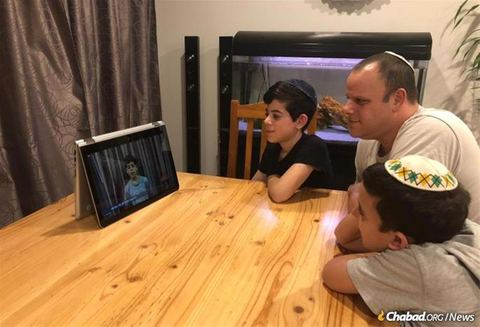 Julian Thomas, 13, has not yet had a bar mitzvah party due to the pandemic, but Rabbi Hecht arranged for him to say one of the 12 Torah verses pre-recorded for the Lag BaOmer online event.