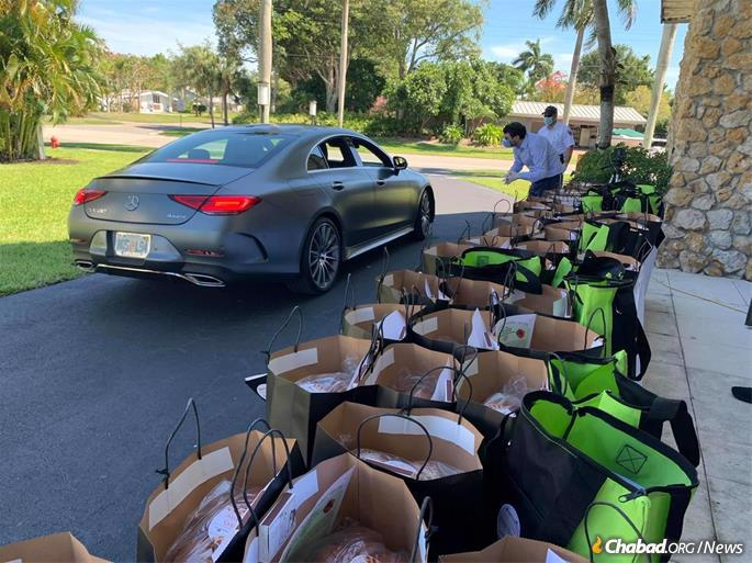 Chabad of Naples, Fla., had a Shabbat drop-off where 175 members drove by to pick up challah, chicken soup, candles and more.