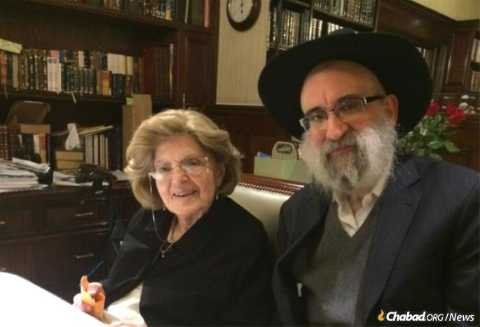Mrs. Levy with one of her sons, Rabbi Don Yoel Levy.