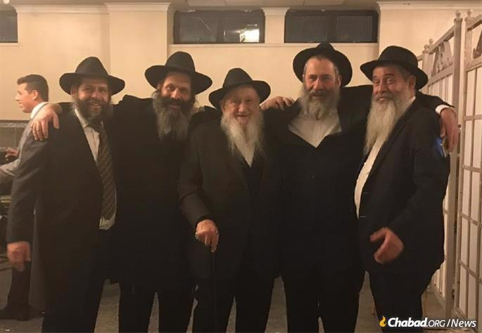Rubashkin was known for his kindness and generosity, but most of all, for his joyous faith in G-d. He is pictured here with his four sons.