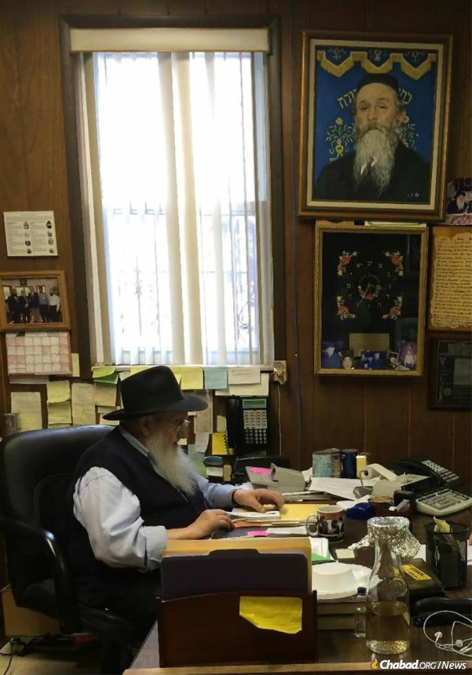 Rubashkin began working in Samarkand, Soviet Uzbekistan, around 1945, going through the daily grind (except for Shabbat and Jewish holidays) until his recent illness. He is pictured in his Borough Park office with the portrait of the Kopizhnitzer Rebbe, for whose kindness he was forever grateful, above his desk.