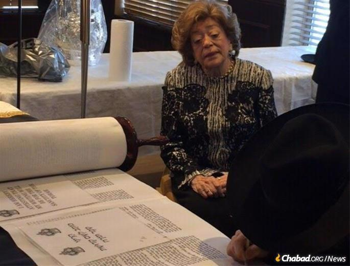 Korenblit watches as the final letters are written in a new Torah scroll.