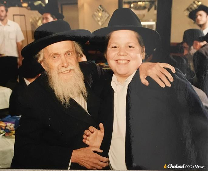 Kopman on the day of his bar mitzvah with Rabbi Moshe Weber, who for decades ran the tefillin stand at the Kotel. (Photo: Courtesy Kopman Family)