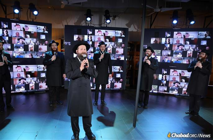 Standing apart from each other, as per protocol, the acapella singers accompanied Cantor Berel Zucker in singing Chabad melodies (Photo: Itzik Roytman).