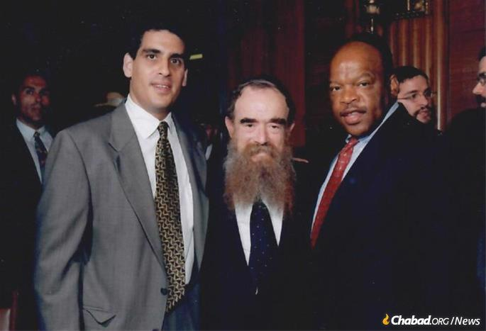 Lewis in the 1990s with his long-time chief of staff Rob Bassin and Rabbi Abraham Shemtov.