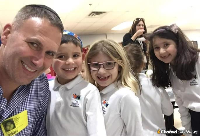One brief enounter with a Jewish message can touch a person's heart and have an impact on generations. Here Feldman joins his daugher and her friends at a school party at the Hebrew Academy in Marlboro, N.J.