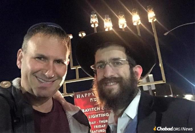 Seth Feldman, left, has developed an active and committed Jewish life. Here, he cebrated Chanukah with Rabbi Yosef Kramer of Chabad of Little Rock, Ark.