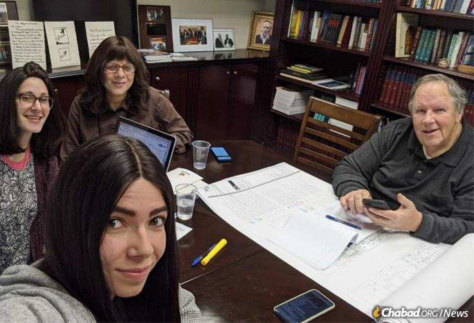 Chaya Schmidt, center, and volunteers meet with the mikvah's architect.