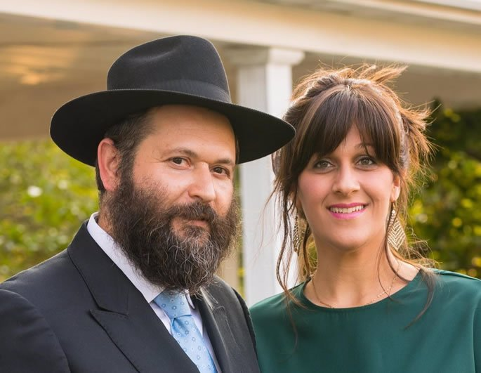 Rabbi Sholom and Malky Goldshmid who helped Irini with her conversion.