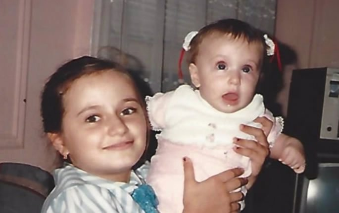 Renata and her little sister shortly after they moved to the US.