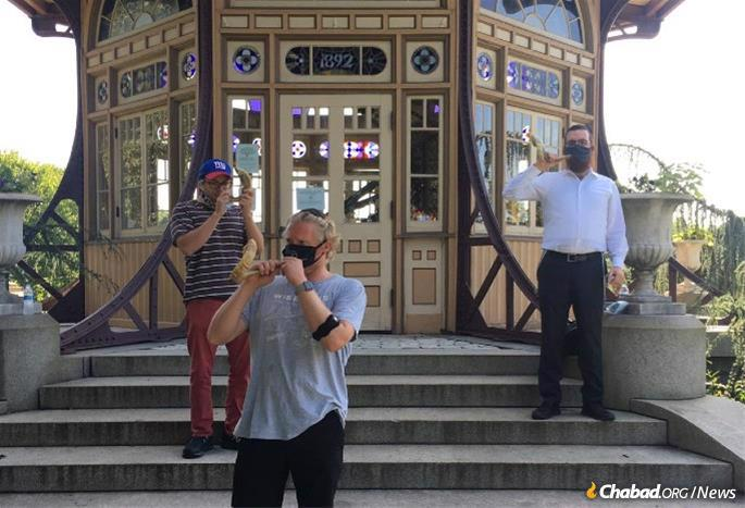 In Baltimore, Rabbi Levi Druk, right, trains local residents to blow the shofar for others on Rosh Hashanah.