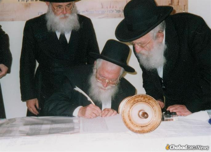 Rabbi Goldberg participating in the completion of the second Jewish Children's Torah Scroll.