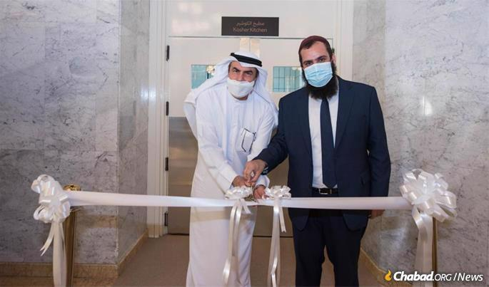 Rabbi Duchman (right) at the ribbon cutting ceremony for the new kosher kitchen at the Armed Forces Officers Club and Hotel in Abu Dhabi. Duchman's kosher supervision service, Emirates Agency for Kosher Certification (EAKC), recently partnered with the Abu Dhabi Department of Culture and Tourism and today certifies a kosher kitchen in both the Armed Forces Officers Club and the Emirates Palace hotel.