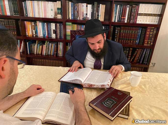 Rabbi Duchman studies with a member of the UAE Jewish community at his synagogue.