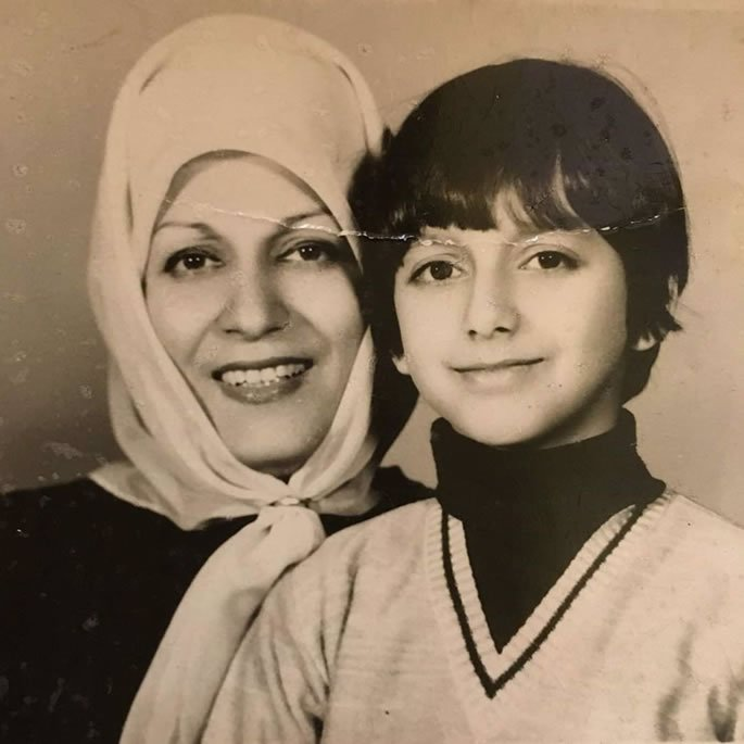 Behdad Moshe with his mother in Iran.
