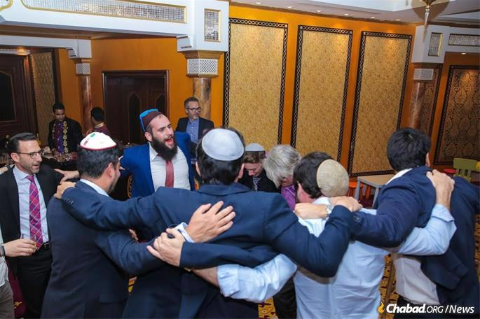 Rabbi Levi Duchman (center) and Jews of the United Arab Emirates celebrate the holiday of Purim at the Burj Al Arab Hotel. Duchman has been the UAE's only resident rabbi for the last six years; the Chabad-Lubavitch movement recently announced his appointment as Chabad emissary to the UAE.