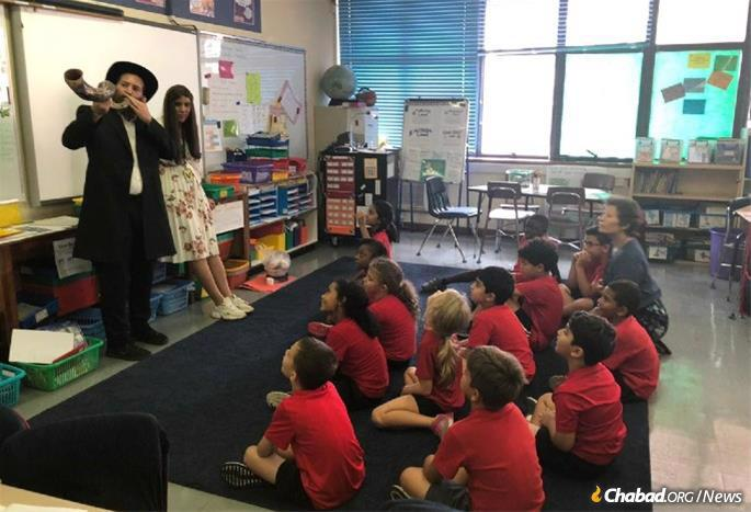 The Sternbachs teach about Rosh Hashanah in Chabad's new school.