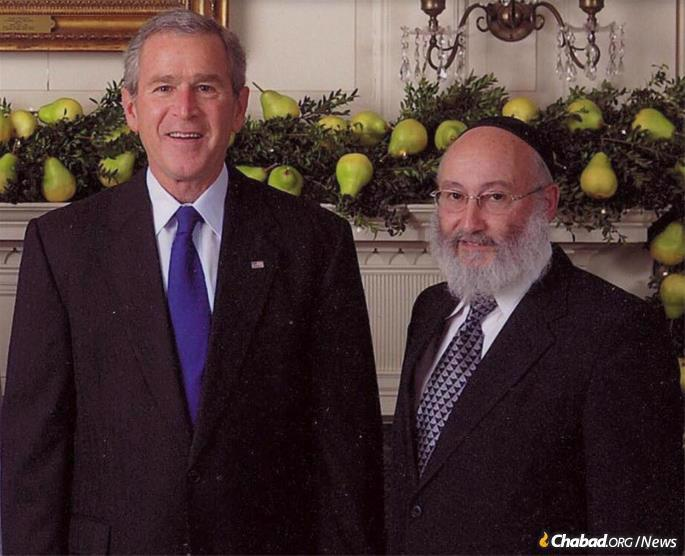 Teitelbaum with U.S. President George Bush at the White House.