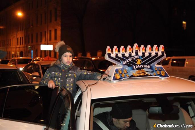 A Jewish child proudly takes part in the parade in St. Petersburg, Russia.