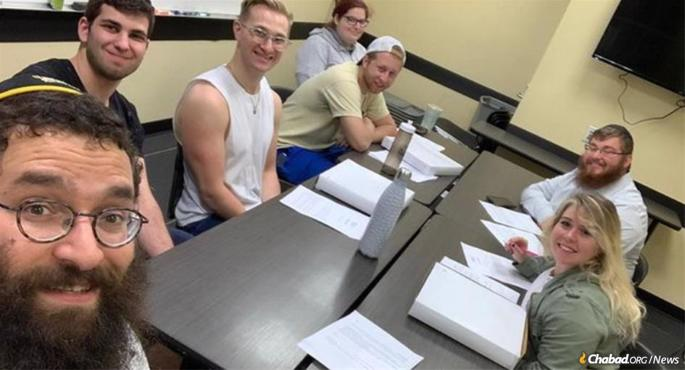 Students at the University of Central Florida with Rabbi Chaim Lipskier, left, take part in the weekly study of the Rebbe's Likkutei Sichot, part of a worldwide effort to study the entire 39 volumes over eight years.