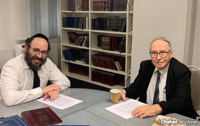 Rabbi Chaim Drukman, left, studies Likkutei Sichot with Justice Elyakim Rubinstein, former Vice President of Israel's Supreme Court and former Attorney General of Israel.