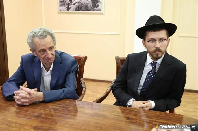 """Rachmiel Leder (left) was born in Birobidzhan and is president of the Birobidzhan Jewish community. He describes Hanukkah in the region as """"a big, beautiful holiday here... It's frosty outside, we have doughnuts, some l'chaim, Jewish songs."""" Next to him is Rabbi Efraim Kolpak, the incoming chief rabbi and Chabad emissary to the region. (Credit: Chabad of Birobidzhan)"""
