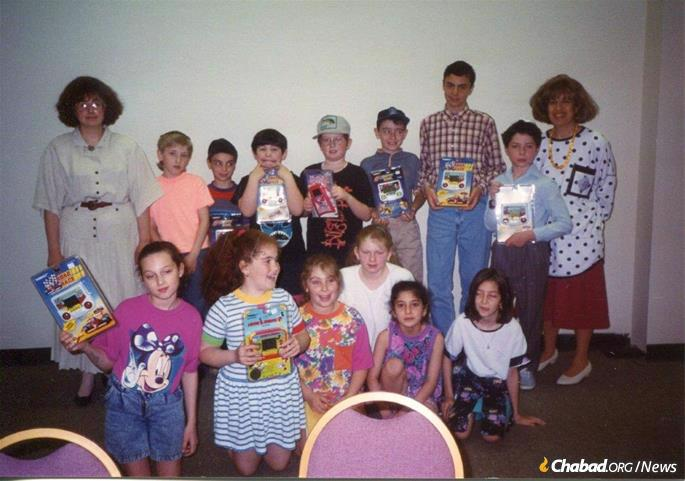 Kosofsky, right, with a group of eager students